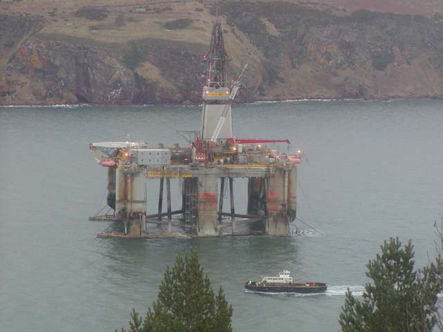 Ship passing oil rig