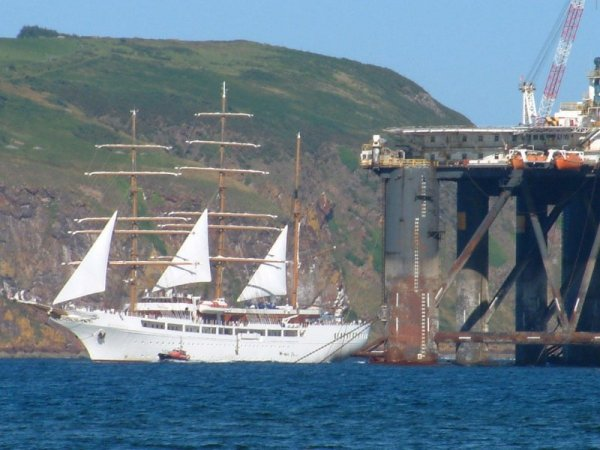 Sea Cloud reduces sail to pick up a pilot