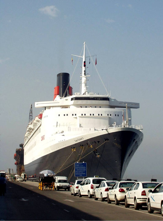 Image of the QE2 and Taxis in Malaga Spain